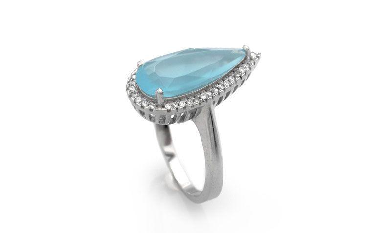"""Anel gota quartzo azul por R$ 96,00 <a href=""""http://www.lumae.com.br/aneis/anel-em-prata-com-rhodium-quartzo-azul-gota-com-borda-cravejada """" target=""""_blank"""">Lumaê</a>"""
