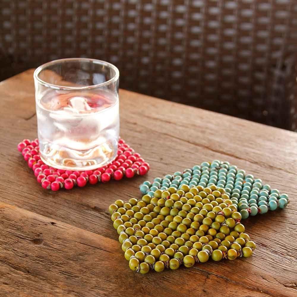 """Porta copos sementes de açaí (2 unidades) por R$ 49 na <a href=""""http://www.redeasta.com.br/casa/mesa-e-cozinha/porta-copos-acai-rosa.html"""" target=""""_blank"""">Rede Asta</a>"""