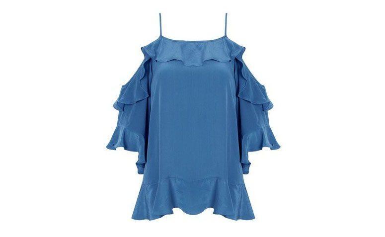 "Blusa de seda Animale por R$668 na <a href=""https://www.oqvestir.com.br/blusa-seda-jabour-azul.html"" target=""blank_"">Oqvestir</a>"