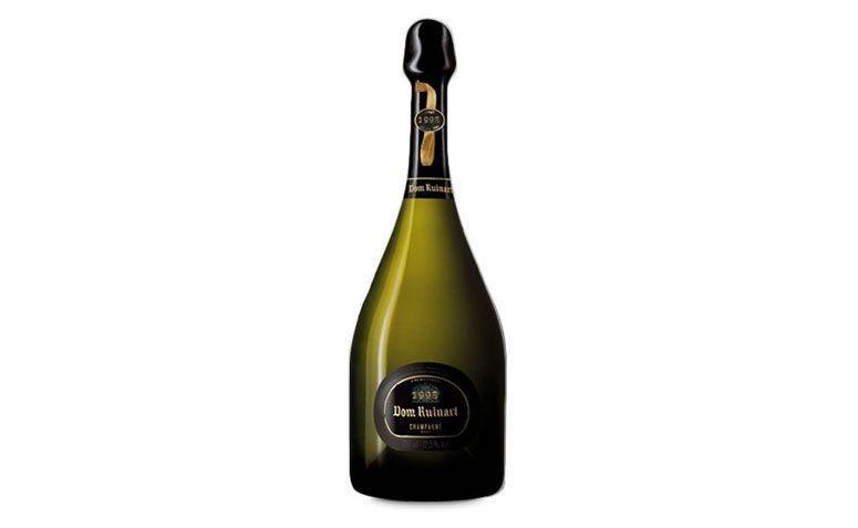"Champagne Dom Ruinart 1998 por R$1080 na <a href=""https://www.wine.com.br/vinhos/champagne-dom-ruinart-1998/prod4190.html"" target=""blank_"">Wine</a>"