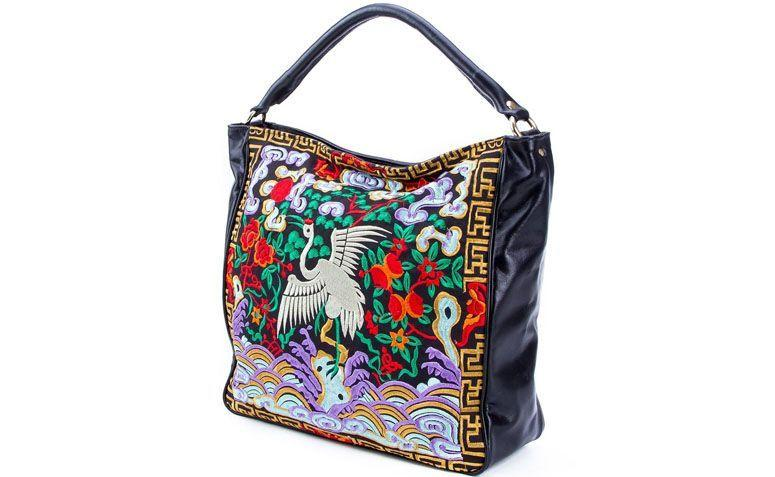 XAA leather embroidered bag by R $ 540.00 in Farfetch