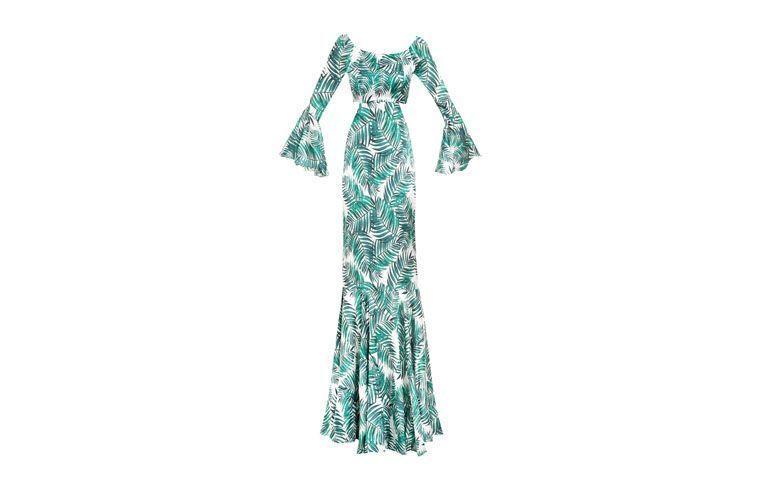 """Vestido de estampa folhagem por R$1.289 na <a href=""""http://shoponline.iorane.com.br/vestido-longo-recorte-cintura-babados-estampa-folhagem-14/p?cc=16"""" target=""""blank_"""">Iorane</a>"""