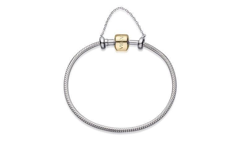 """Pulseira de prata com fecho de ouro por R$1.650 na <a href=""""http://www.vivara.com.br/produto/pulseira-life-com-corrente-de-seguranca-em-prata-e-ouro-amarelo-18-cm/PL00015212"""" target=""""blank_"""">Vivara</a>"""