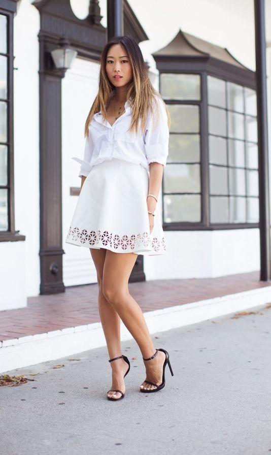 "Foto: Reprodução / <a href=""http://www.songofstyle.com/2014/05/white-shirt-white-cut-skirt.html"" target=""_blank"">Song of Style</a>"