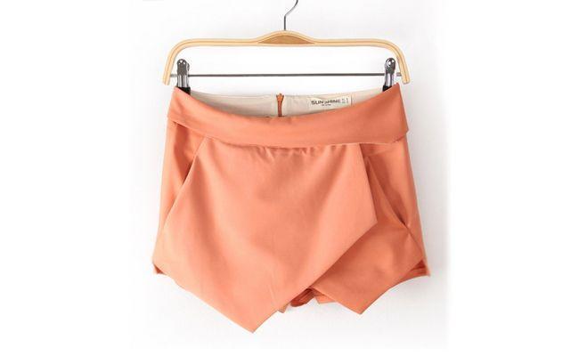 "Skort assimétrico salmão por US$27,63 no <a href=""http://www.aliexpress.com/item/Fashion-female-13-back-zipper-irregular-geometry-type-solid-color-shorts-skorts/1115458211.html"" target=""blank_"">AliExpress</a>"