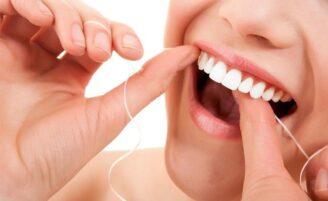 Como usar o fio dental corretamente