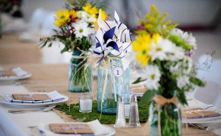 Floral centerpieces are basically a given at receptions. They help you decorate your event's space with the colors in your palette, and add dimension to any table.