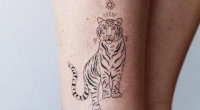 Tatuagem de tigre feminina: 70 ideias incríveis para despertar a coragem